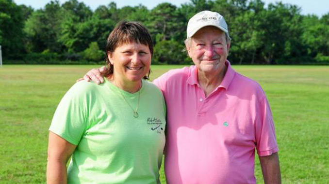 Camp director Frannie Slabonik, left, poses with former director and owner Richard Miller. DAN COOK PHOTO